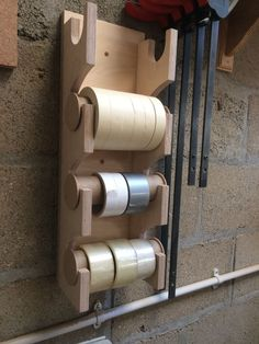 Great shop made storage for tape and sandpaper rolls.