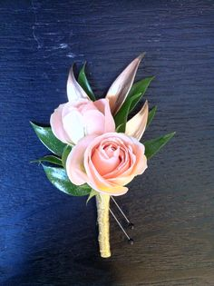 Boutonniere-Light pink spray roses, gold Italian ruscus with champagne ribbon stem wrap: $12.50
