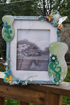 This is a non flash view of the same frame. Using Spellbinders Goddess dies(both), Dimensions Pearlescemnt Past, Kaisercraft Cardstock, Prima Stencil, flowers, butterflys, trinkets, Creative Expressions Med Glass Beads, & Dazzler