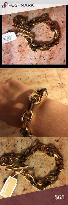 NWT Michael Kors tortoise bracelet Brand new Michael Kors chain link bracelet in gold tone and tortoise. Thick toggle and signature charm. Retail 125!! Michael Kors Jewelry Bracelets