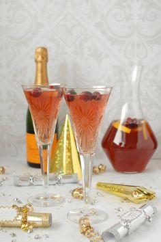 Oh so pretty! Cranberry-Orange Champagne Punch - BoulderLocavore.com #cocktail