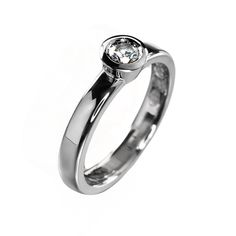 Solitaire ring with bezel setting.
