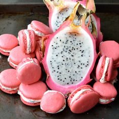Dragonfruit Macarons - (although the ones in the picture look questionable), the idea is great. Would be nice to put some black sugar or something around the edges of the buttercream to mimic the seeds Macarons, Macaron Cookies, Macaron Dessert, Cookie Recipes, Dessert Recipes, Macaron Flavors, French Macaroons, Macaroon Recipes, Ice Cream Desserts