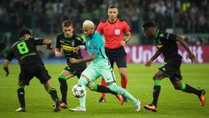Barcelona's Brazilian forward Neymar (C) is challneged by Moenchengladbach's midfielder Mahmoud Dahoud (L), Moenchengladbach's Belgian midfielder Thorgan Hazard (2ndL) and Moenchengladbach's French midfielder Ibrahima Traore   during the UEFA Champions League first-leg group C football match between Borussia Moenchengladbach and FC Barcelona at the Borussia Park in Moenchengladbach, western Germany on September 28, 2016. / AFP / Odd ANDERSEN