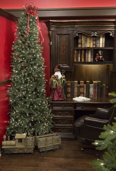 Bring the warmth and magic of Santa's office into your home with inspiration from Nebraska Furniture Mart. Use the traditional red and green color palette along with wood, leather and velvet textures to achieve the look.