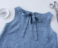 How To Sew and Attach a Back Tie Tutorial. Sewing tip for a back opening bow closure for tops, blouses, or dresses.