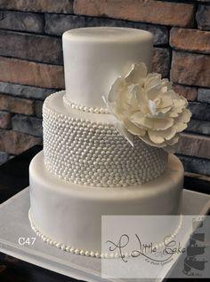 This contemporary fondant iced wedding cake has fondant pearl beads. http://www.alittlecake.com/fondant-pearl-wedding-cake/