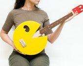 Pac Man ukulele  (paculele) found on etsy. Custom Made by Celentano Woodworks