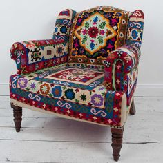 "Furniture - Crewel Hand-Embroidered Maharajah Armchair - Hutsly. A stunning statement piece, this Maharajah chair was handmade in India using a traditional embroidery technique called ""crewel"". Featuring carved solid wood legs and folk patterned fabric, it is one of our favourite pieces, a true masterpiece!"