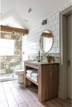 white tile walls + circle mirror