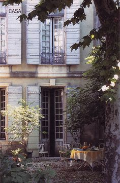 Old and beautiful home, gravel yard, long narrow windows and shutters