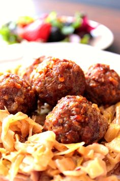 These super moist and flavorful pork meatballs with Dijon mustard and pretzels pair perfectly with creamed caraway cabbage. Kudos Kitchen by Renee