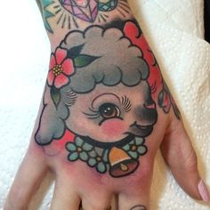 little lamb children's book illustration style hand tattoo