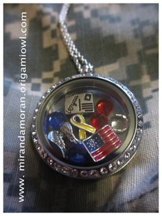 Here is my very own Military themed Origami Owl Living Locket! The fact that i could create something so personal to represent my life as an Army Wife, led me to become an Origami Owl Independent Designer. I wanted to share my excitement with other Military wives as well as the rest of the world. These Lockets are a beautiful way to share your story to the world, or to simply keep them close to your heart. Tell me YOUR STORY!!  Order your Origami Owl Locket at www.mirandamoran.origamiowl.com
