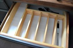 Time for a more organized kitchen! This easy to make custom DIY silverware drawer organizer makes better use of space than a store-bought version! Diy Cutlery Trays, Silverware Drawer Organizer, Kitchen Drawer Organization, Kitchen Drawers, Kitchen Organization, Organized Kitchen, Organizing, Kitchen Organizers, Kitchen Cabinets