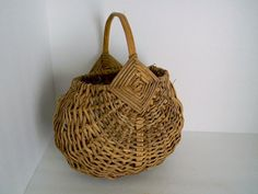 this basket is gorgeous. Antique Basket Gods Eye Primitive Early 1900s Country Home Decor. $35.00, via Etsy.