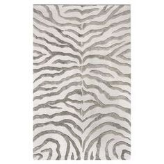 exotic design makes a splash on this hand tufted area rug eye catching gray zebra stripes captivate across the plush ivory floor covering wool chic zebra print rug