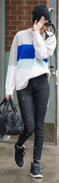 Kendall Jenner: Purse – Givenchy  Key chain – Fendi  Pants – Res  Sweater – Proenza Schouler