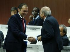 FIFA President Sepp Blatter (R) shakes hands with Prince Ali bin Al Hussein of Jordan at the 65th FIFA Congress in Zurich, Switzerland, May 29, 2015. REUTERS/Ruben Sprich