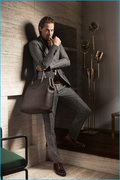 James Rousseau dons fine suiting for Salvatore Ferragamo's fall-winter 2016 campaign.