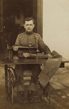 PORTRAIT-OF-AN-ARMY-TAILOR-AND-HIS-SEWING-MACHINE-IN-SERBIA-VINTAGE-RPPC