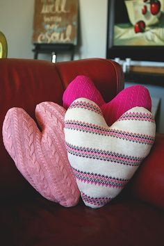 Don't throw out your old sweaters! Put them to good use and create these warm and fluffy sweater heart pillows.