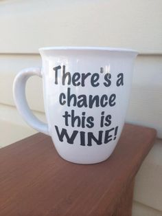 Tina/Kelly:  found it on Etsy! There's a chance this is WINE Funny Coffee by PrettyLittleVinyls, $12.00