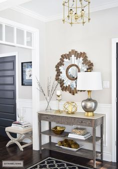 ONE TABLE FOR WAYS : Shop your own home to create unique and new styling displays | GOLD | METALLIC | WOOD CONSOLE TABLE | STARBURST MIRROR | ENTRYWAY | FOYER