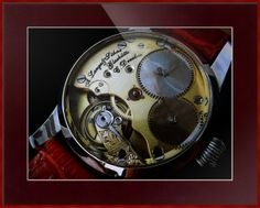 """A. Lange & Sohne Swiss Watch // Paper: enhanced matte; Glazing: acrylic; Moulding: colorful, tornado red, square metal frame; Top Mat: red, cabernet // Price starts at $113 (Petite: 16.75"""" x 18.75""""). // Customize at http://www.imagekind.com/A-Lange--Sohne-Swiss-Timepiece_art?IMID=f59c96d5-ffd1-4161-90e3-0361617473b8"""