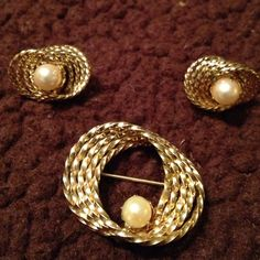 12 karat gold filled brooch and earring set Beautiful brooch and earrings is done with like a ribbon effect and then one single pearl in the center of them...done really gorgeously Vintage Jewelry Brooches