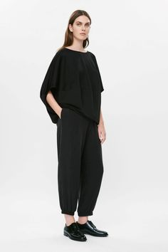 Circle cut for a softly rounded shape, this top is made from panels of contrasting jersey fabric. Loose and oversized, it has a wide round neckline, dropped shoulder seams and a seam detail along the back. Cos Tops, Cut Sweatshirts, Cashmere, Contrast, Normcore, Silk, Fabric, Cotton, How To Wear