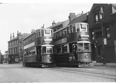 Its June 1936 as two similar London Transport trams pass in Highgate Village.