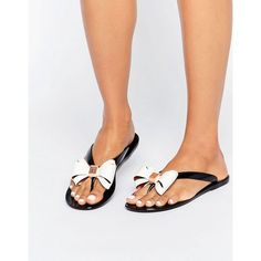 Ted Baker Rafeek Bow Black Flip Flops (245 ILS) ❤ liked on Polyvore featuring shoes, sandals, flip flops, black, jelly sandals, black flip flops, embellished sandals, embellished thong sandals and black slip on shoes