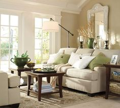 Love the neutral colors with a touch of green.  Family room decorating
