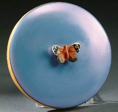 A NORITAKE ART DECO FIGURAL POWDER BOX CIRCA 1925 WITH MOLDEDBUTTERFLY FINAL