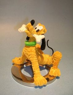 Disney& Pluto -He is Pipe Cleaners inches tall -Sitting on a inch diameter chromed metal ring I salvaged from an old Computer Monitor/Swivel Stand (I think.) Birthday Present fo. Pipe Cleaner Projects, Pipe Cleaner Art, Pipe Cleaner Animals, Pipe Cleaners, Cute Crafts, Crafts For Kids, Arts And Crafts, Animal Crafts, Disney