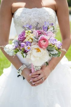 Pastel pinks lavenders and blues Bridal Bouquet with hydrangea, roses, peony and dusty miller by Twig Floral Designs, Carbondale,  Illinois www.twig-designs.com Jonathan Reiman Designer. Photo by KC Photography