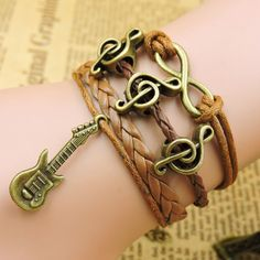 This boho-chic guitar bracelet is everything! Literally. Braded leather with infinity symbol, guitar pendant and treble music note, all in the same place! What more do you want? - 40% OFF - FREE SHIPP