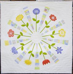 Flower Wheel Quilt, made with a 9-degree Dresden wedge, by Cynthia Muir