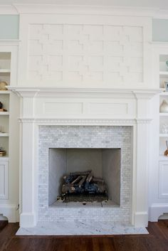 Marble Fireplace - Design photos, ideas and inspiration. Amazing gallery of interior design and decorating ideas of Marble Fireplace in bedrooms, living rooms, kitchens by elite interior designers. Fireplace Redo, Fireplace Hearth, Fireplace Remodel, Fireplace Surrounds, Fireplace Design, Fireplace Tiles, Fireplace Molding, Fireplace Kitchen, Small Fireplace