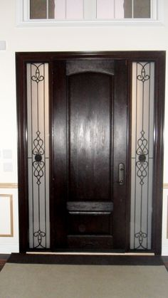 Cherry grain, dark walnut fiberglass door with wrought iron sidelites in Toronto, Ontario