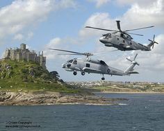 A Merlin HM Mk1 helicopter from RNAS Culdrose, with a Seahawk from the Australian Navy by Defence Images, via Flickr