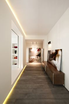 apartment in rome, carola vannini - I love the use of lighting and art.