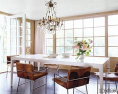 I love this simplistic concept. Gorgeous chairs and fixtures + lots of windows = true beauty.