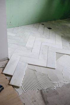 Try This Herringbone Marble Tile (A Beautiful Mess) is part of Tiles This past week we& been making some MAJOR progress on the master bathroom It& been our late bloomer you could say While mo - Marble Tile Bathroom, Marble Tiles, Bathroom Floor Tiles, Bathtub Tile, Bathroom Cabinets, Shower Floor, Kitchen Floor, Kitchen Tiles, Entryway Tile Floor