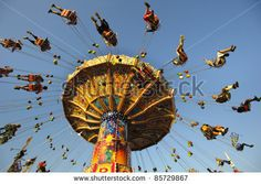 "MUNICH, GERMANY - SEPTEMBER 21: chairoplane with flying people of world biggest beer festival ""Oktoberfest in Munich"" on September  21, 2011..."