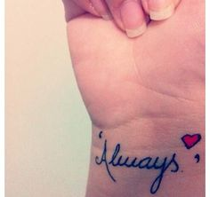 Wrist tattoo . I think it would be cute if a married couple both got this tattooed on them. ❤