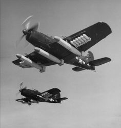 Martin AM-1 Maulers in flight (Date and location unknown)