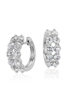 Perfect for a look of sheer elegance, these hoop earrings feature two rows of sparkling round brilliant diamonds framed in 14k white gold.