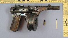 This is attributed to be a handmade submachine gun found on a Finnish thief. It is chambered in .22LR and has a sizeable drum magazine.